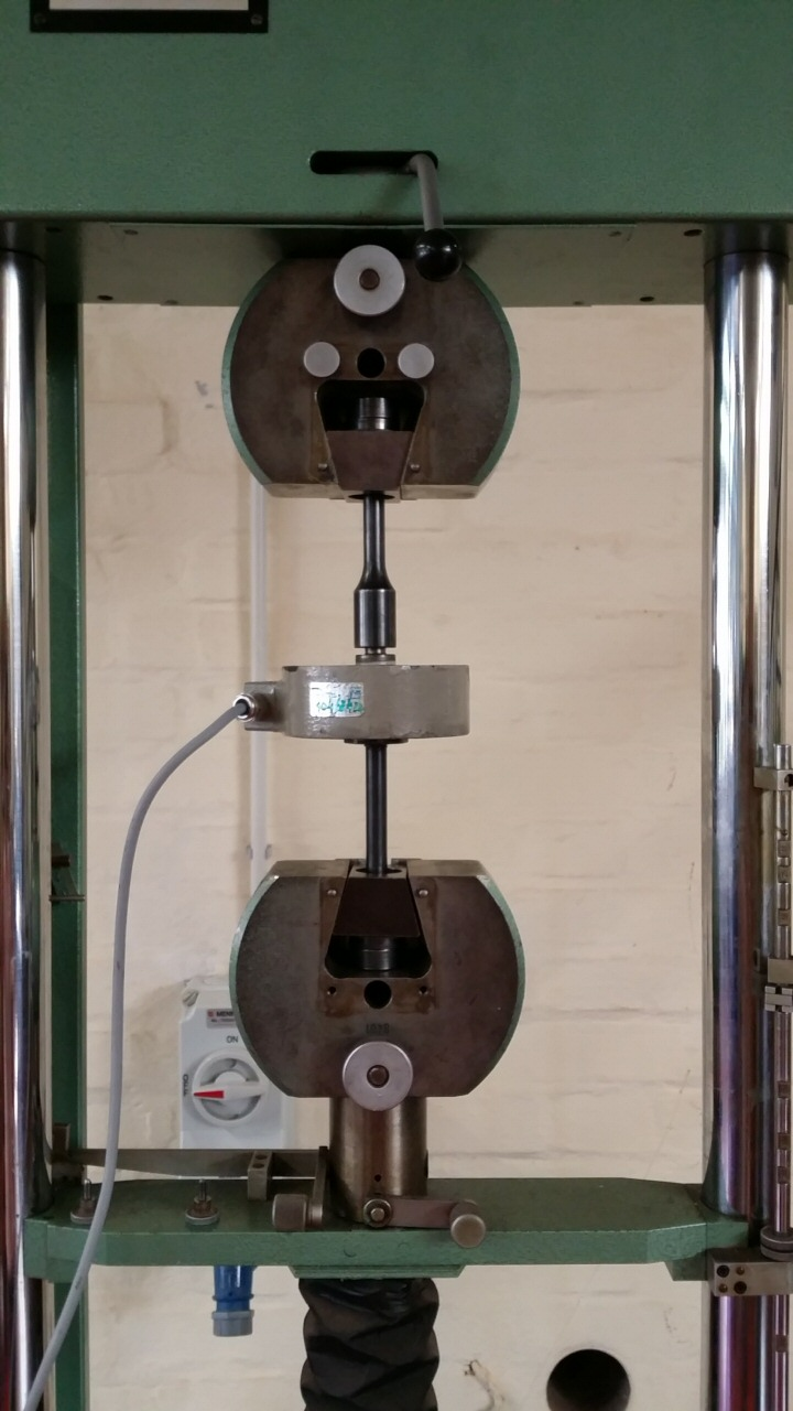 Force transducer placed inside the tensile testing machine during calibration